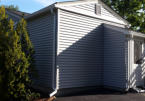 After. CertainTeed Monogram Silver Gray Siding white Composite Trim.